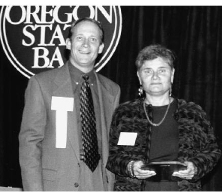 1998 Linda Clingan of the Campaign for Equal Justice receives the President's Special Award of Appreciation from Mark Johnson, OSB President, 1999